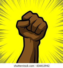brown fist with yellow background