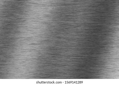 Brushed  dark metal texture. Polished metal  background with light reflection.