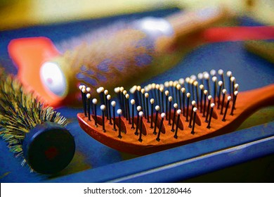 Brushes and combs for hair on the table at the hairdresser.The picture is made using a filter on photoshop.