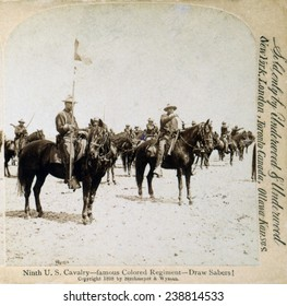 Buffalo soldiers of the Ninth U.S. Cavalry--famous Colored Regiment--Draw Sabers! stereocard ca. 1898
