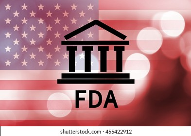Building icon with inscription FDA and flag of The United States over abstract background.
