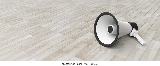 Bullhorn, megaphone white with black details on grey wooden floor background. Close up front view, banner, copy space. 3d illustration