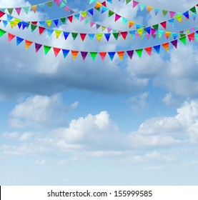 Bunting flags on a blue sky as a group of hanging an advertising and marketing icon of happy celebration for a birthday or special event as a design element for communication with copy space.