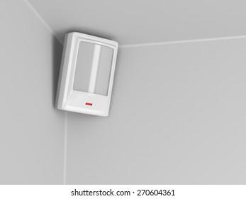 Burglar alarm motion sensor on grey wall
