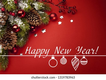 burgundy background with a smooth transition to the dark side. branch spruce with cones with New Year's toys and stars. inscription happy new year.