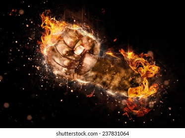 Burning fist of fire on black background. Concept image for fights, strikes or revolutions
