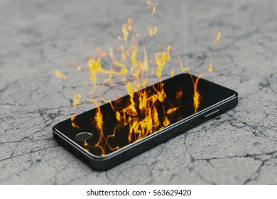 Burning smartphone with delicate flames. Burning smartphone with bad battery exploded or overloaded processor - 3D illustration.