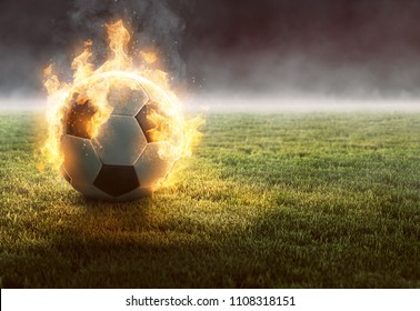 Burning Soccer Ball on Gras (3D Rendering)