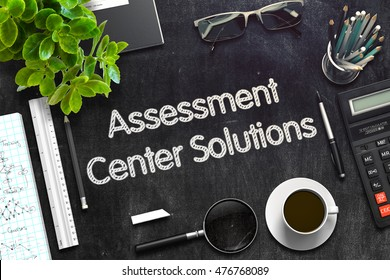 Business Concept - Assessment Center Solutions Handwritten on Black Chalkboard. Top View Composition with Chalkboard and Office Supplies on Office Desk. 3d Rendering. Toned Image.