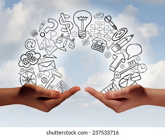 Business exchange concept as two human hands from diverse cultural backgrounds exchanging financial and economic information and training as a metaphor for team success.
