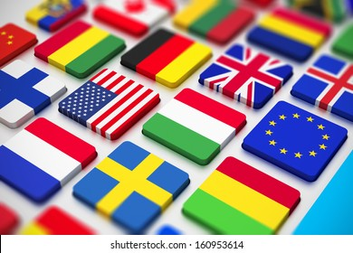 Business, international communication and cartography technology corporate office concept: close macro view of computer PC keyboard from colorful world countries flags with selective focus effect