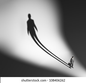 Business man casting a long and dramatic shadow