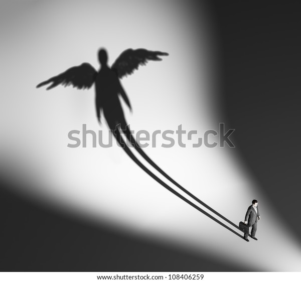 Business man casting a winged silhouette shadow