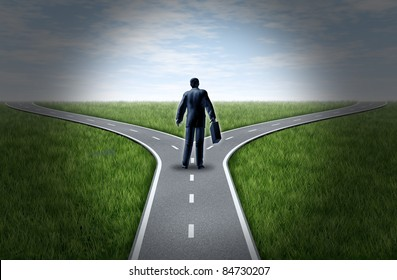 Business man at a cross roads standing at a fork in the road representing the concept of a strategic dilemma choosing the right direction to go when facing two equal or similar options.