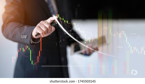 business man pointing index finger to investing chart