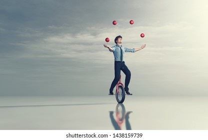 Business man riding unicycle and juggling with some balls. This is a 3d render illustration