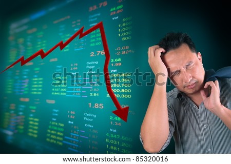 Business man stress about falling of stock market