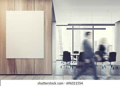Business people in an office lobby with a glass and wooden walls, a vertical poster and an open office environment with white computer tables and loft windows. 3d rendering mock up