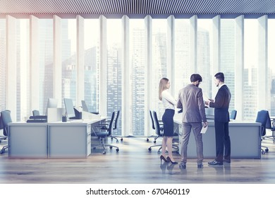 Business people in an open space office interior with a wooden floor, a panoramic window with shades, rows of computer tables and office chairs. Film effect. 3d rendering mock up toned image
