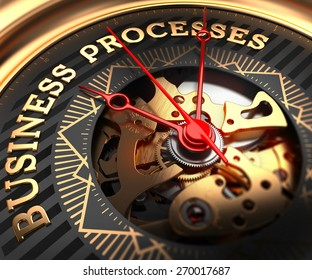 Business Processes on Black-Golden Watch Face with Watch Mechanism. Full Frame Closeup.