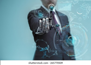 Businessman With Artificial Robotic Hand working on virtual holographic interface. Future technology as design concept.