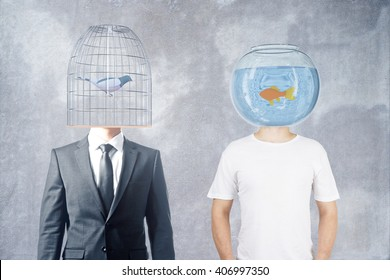 Businessman and casually dressed man with fishtank and birdcage instead of heads on concrete background, 3D Rendering