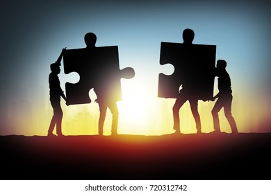 businessman connecting jigsaw puzzle pieces