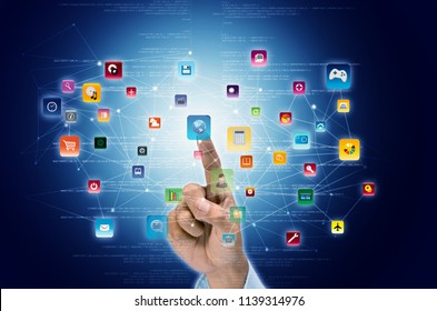 A businessman hand click on flying software and application icon inside internet virtual network