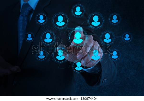 businessman hand points the human resources, CRM and social media diagram as concept