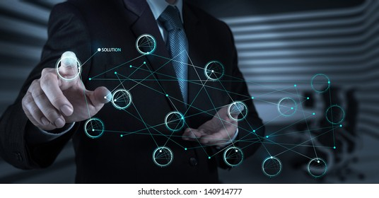 businessman hand pushing solution diagram on a touch screen interface as concept