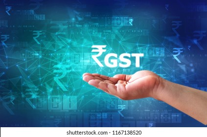 Businessman Holding GST India Word, GST Tax India Concept with business graph