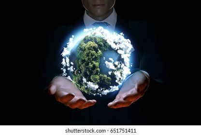 Businessman holding the world in the palm of hands. Concept for global business, 3d illustration