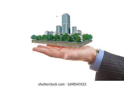 Businessman holds in his hand a piece of land with business district. 3d illustration