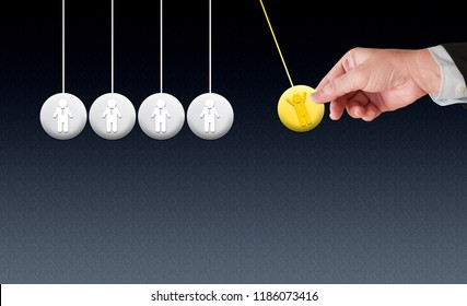 Businessman icon hanging newton cradle pendulum symbol, yellow one as the leadership,Momentum as a group of business teamwork,partnership, collaboration concept,copy space.
