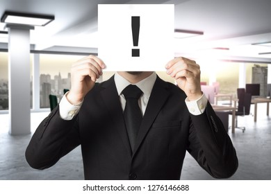 businessman in large modern office hides face behind sign exclamation mark3D Illustration