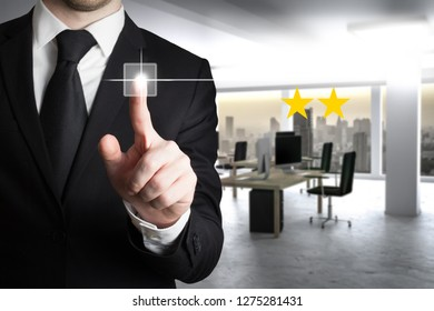 businessman in large modern office pushing virtual button two star review 3D Illustration
