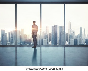 Businessman looking at city. 3d render