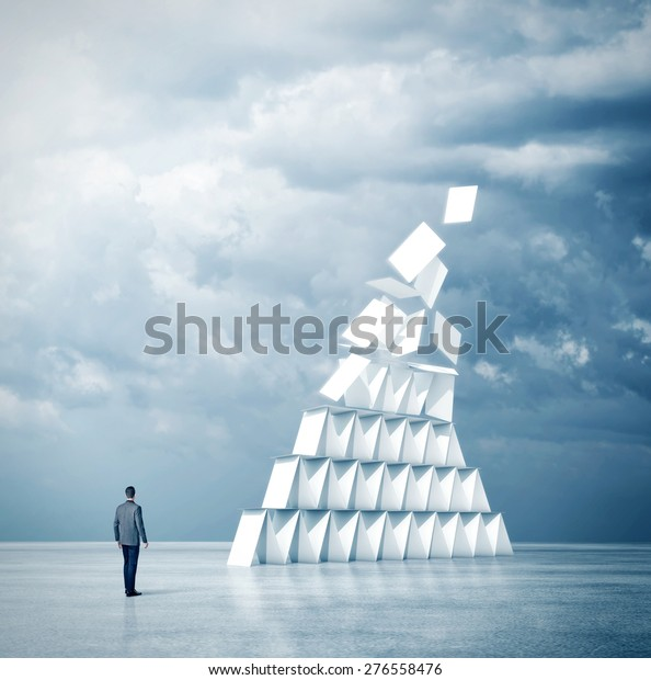 Businessman looks at house of cards. 3d rendering