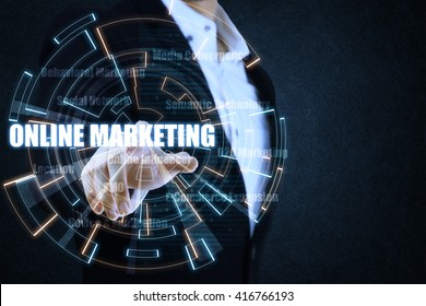 The businessman pointing the blue and orange circle of light by focusing on strategy of on-line marketing. This picture suitable for business and technology use.