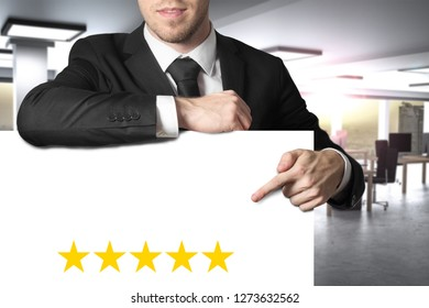 businessman pointing on blank banner with five golden stars advertising 3d illustration