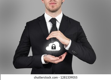 businessman protects cloud data symbol with his hands malware
