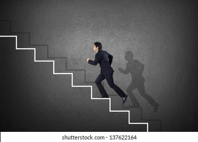 businessman run up on ladder