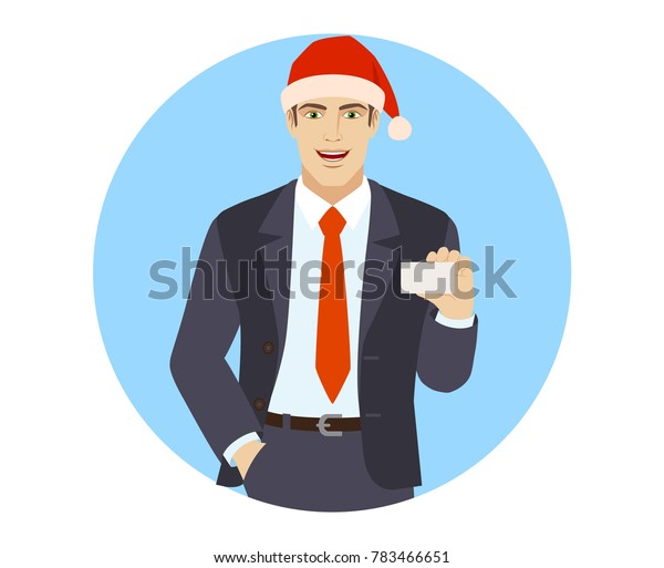 Businessman in Santa hat with hand in pocket showing the business card. Portrait of businessman in a flat style. Raster illustration.