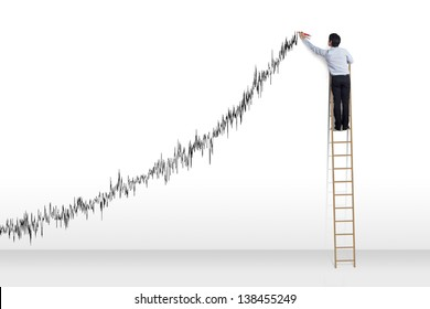 Businessman standing on ladder drawing diagrams and growth graph