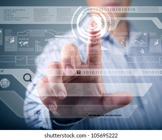 Businessman standing and working wth touch screen technology
