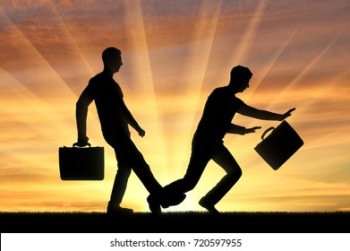 Businessman stumbles on the leg of another businessman. The concept of risk and rivalry in business