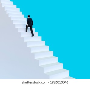 businessman walk up the stairs. business concept growth and the path to success. 3D render