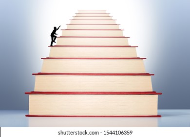 Businessman walking on stack of Books  to knowledge, success, career. Through education and learning to success concept.