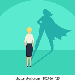 Businesswoman with superhero shadow concept. Business symbol of emancipation ambition and success motivation. Leadership or courage and challenge.