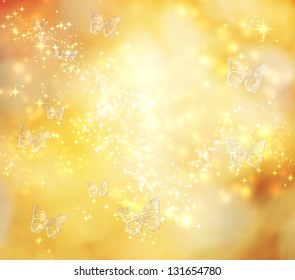 Butterfly on yellow abstract lights background